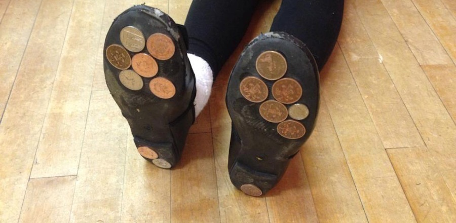 Why Are Parents Gluing Pennies To The Bottom Of Their Kids' Shoes?